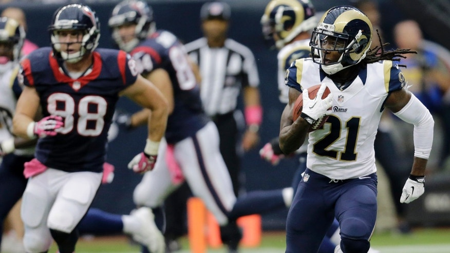 St. Louis Rams cornerback Janoris Jenkins (21) runs back an interception from Houston Texans quarterback T.J. Yates during the fourth quarter of an NFL football game Sunday, Oct. 13, 2013, in Houston, Texas. The Rams won 38-13. (AP Photo/Eric Gay)