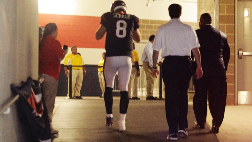 Houston Texans quarterback Matt Schaub (8) leaves the field with an injury during the fourth quarter of an NFL football game against the St. Louis Rams Sunday, Oct. 13, 2013, in Houston, Texas. He'd been injured during the fourth quarter. The Rams won 38-13. (AP Photo/Patric Schneider)