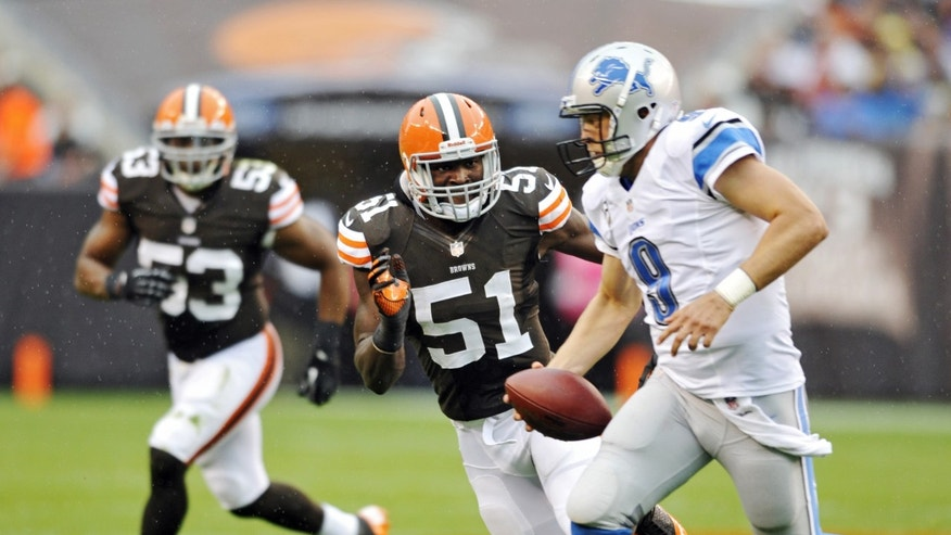 Cleveland Browns linebacker Barkevious Mingo (51) chases Detroit Lions quarterback Matthew Stafford (9) in the second quarter of an NFL football game Sunday, Oct. 13, 2013 in Cleveland. (AP Photo/David Richard)