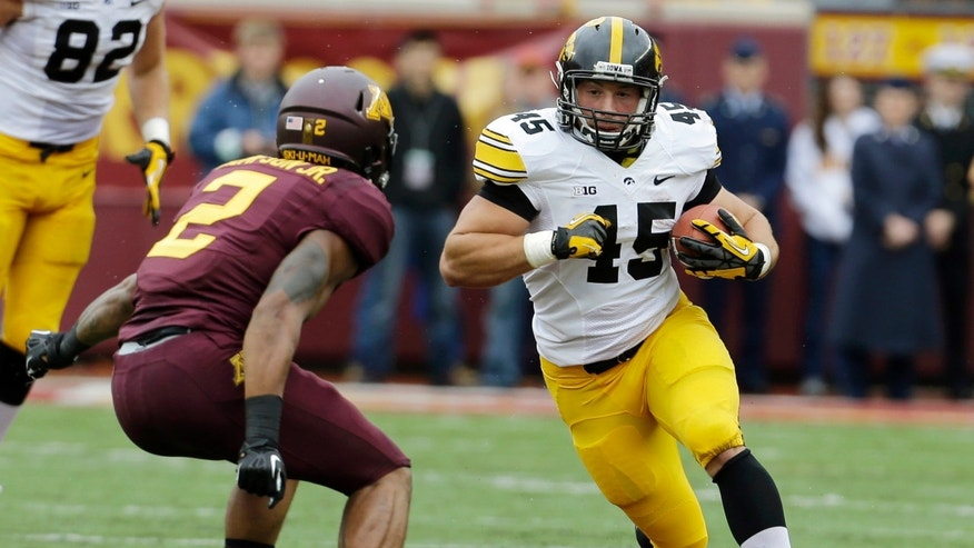 FILE - In this Sept. 28, 2013, file photo, Iowa Hawkeyes fullback Mark Weisman (45) carries the ball during the first quarter of an NCAA college football game against Minnesota in Minneapolis. Iowa and Ohio State have had an extra week to get ready for Saturday's game. (AP Photo/Ann Heisenfelt, File)