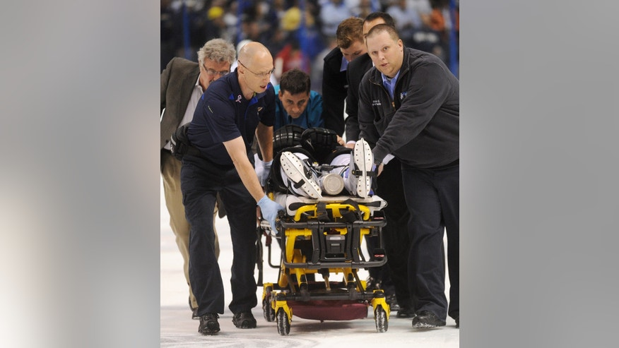 San Jose Sharks' Dan Boyle, on stretcher, is taken from ice during the first period of an NHL hockey game against the St. Louis Blues on Tuesday, Oct. 15, 2013, in St. Louis. (AP Photo/Bill Boyce)