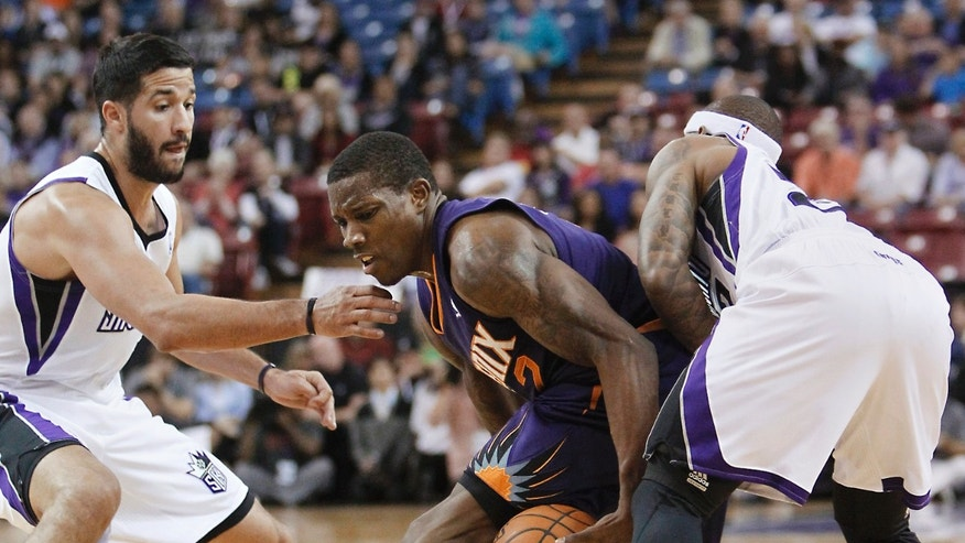 Phoenix Suns guard Eric Bledsoe, center, is double-teamed by Sacramento Kings' Greivis Vasquez, left, and Isaiah Thomas during the first quarter of an NBA preseason basketball game in Sacramento, Calif., Thursday, Oct. 17, 2013.(AP Photo/Rich Pedroncelli)