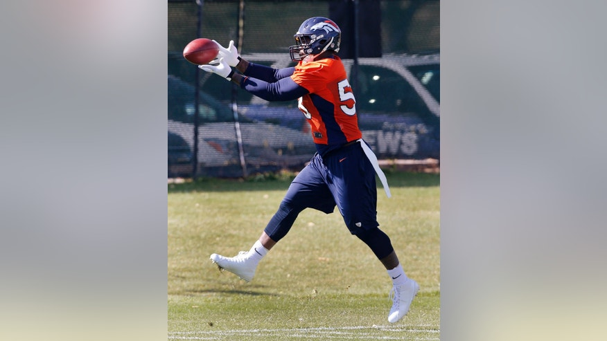 Denver Broncos linebacker Von Miller pulls in a pass during practice at the NFL football team's practice facility in Englewood, Colo., Wednesday, Oct. 16, 2013. It was the first practice with the team for Miller since August as he completed a six game suspension for violating the leagues substance abuse rules. (AP Photo/Ed Andrieski)