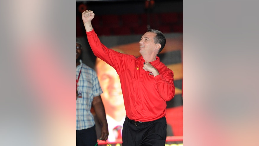Maryland men's basketball coach Mark Turgeon pumps his fist to the crowd during Maryland Madness college basketball event, Friday, Oct. 18, 2013, in College Park, Md. (AP Photo/Nick Wass)