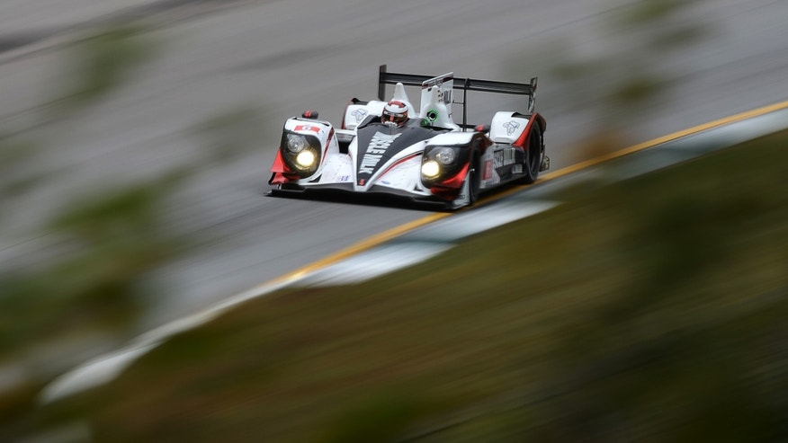 Lucas Luhr, of Germany, drives the Pickett Racing HPD ARX-03c during practice for the American Le Mans Series' Petit Le Mans auto race at Road Atlanta, Friday, Oct. 18, 2013, in Braselton, Ga. (AP Photo/Rainier Ehrhardt)