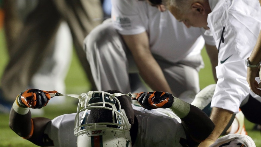 Miami's Phillip Dorsett lies injured following a play against North Carolina during the first half of an NCAA college football game in Chapel Hill, N.C., Thursday, Oct. 17, 2013. Miami won 27-23. (AP Photo/Gerry Broome)