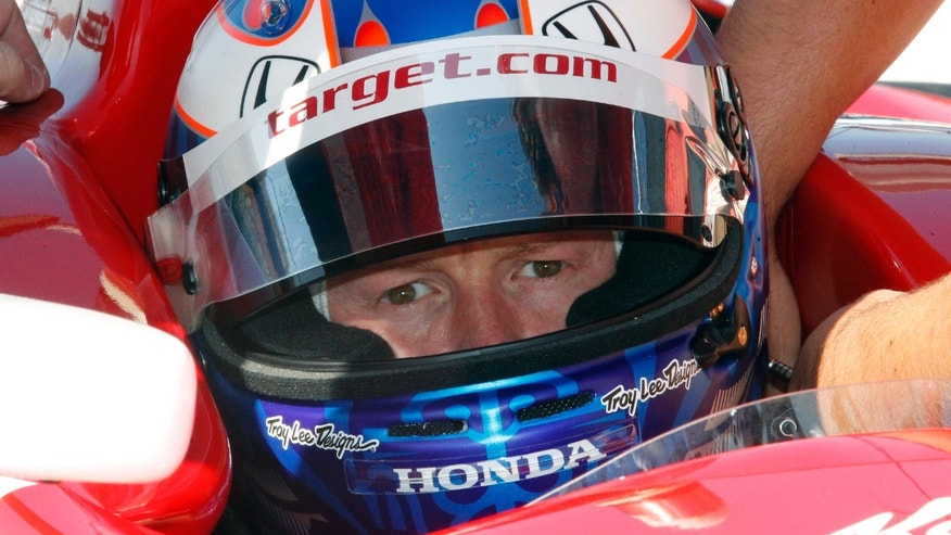 Driver Scott Dixon, of New Zealand, sits inside his car during a practice round for the MAVTV 500 IndyCar World Championship Race at Auto Club Speedway, Friday, Oct. 18, 2013 Fontana, Calif. (AP Photo/Alex Gallardo)