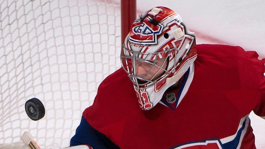 Montreal Canadiens goalie Carey Price watches the puck fly pass his net during the second period of an NHL hockey game, Thursday, Oct. 17, 2013 in Montreal. (AP Photo/The Canadian Press, Peter McCabe)