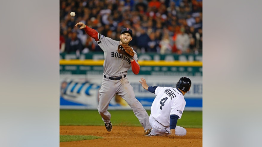 Boston Red Sox's Stephen Drew throws to make a double play after forcing out Detroit Tigers' Omar Infante at second in the fourth inning during Game 5 of the American League baseball championship series Thursday, Oct. 17, 2013, in Detroit. (AP Photo/Paul Sancya)