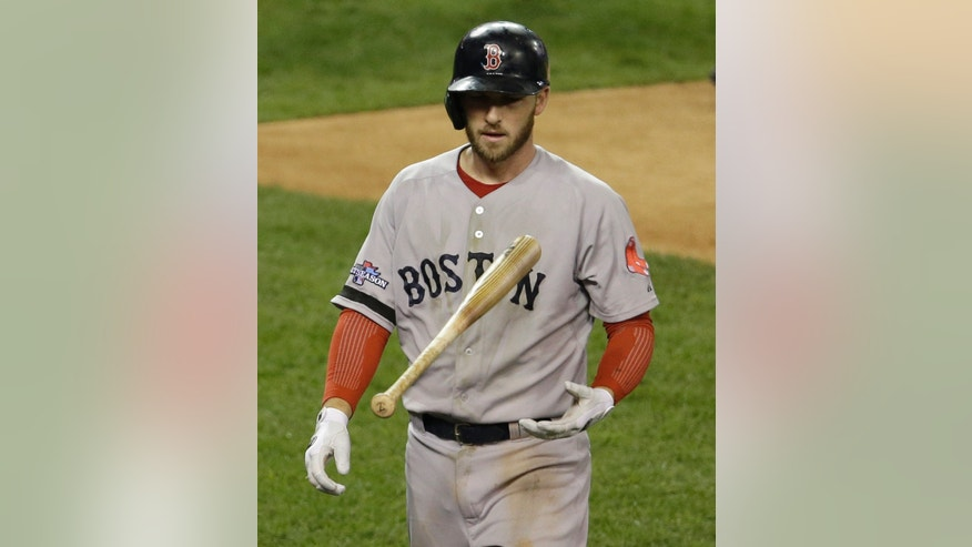 Boston Red Sox's Stephen Drew tosses a bat after striking out in the second inning during Game 5 of the American League baseball championship series against the Detroit Tigers, Thursday, Oct. 17, 2013, in Detroit. (AP Photo/Carlos Osorio)