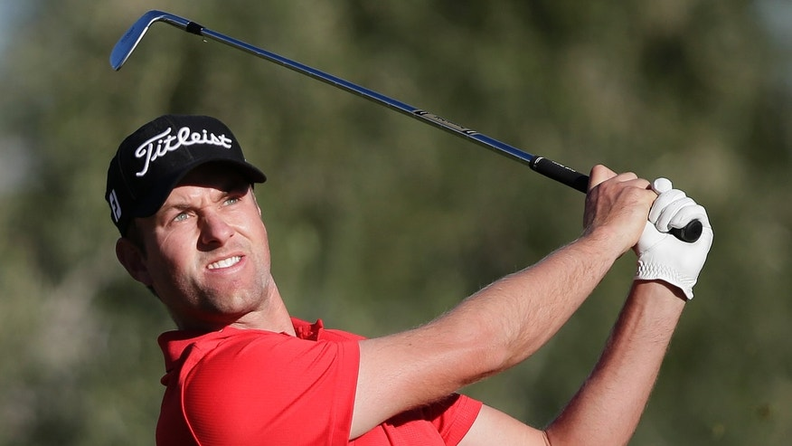 Webb Simpson tees off on the 14th hole in the second round of the Shriners Hospitals for Children Open golf tournament, Friday, Oct. 18, 2013, in Las Vegas. (AP Photo/Julie Jacobson)