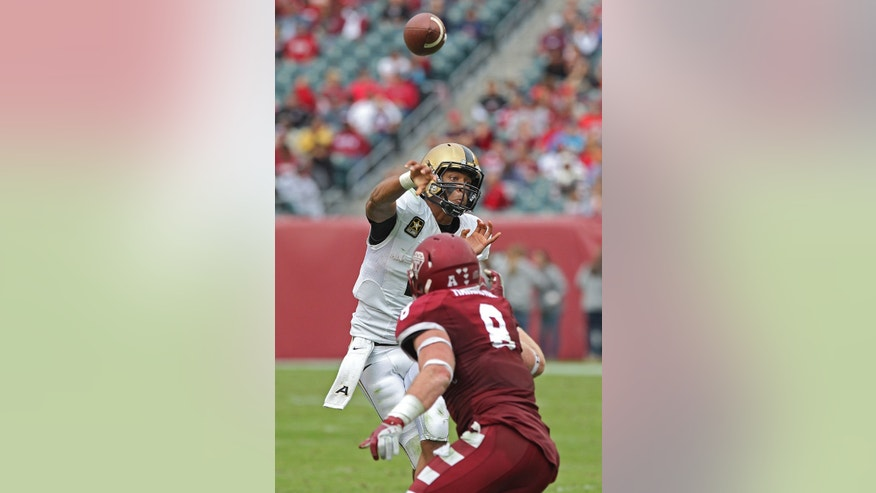 Army quarterback Kelvin White throws over Temple linebacker Tyler Matakevich for a touchdown to Patrick Laird during an NCAA college football game Saturday, Oct. 19, 2013, in Philadelphia. Temple won 33-14. (AP Photo/Philadelphia Inquirer, Michael Bryant) PHIX OUT  NEWARK (N.J.) OUT  TV OUT  MAGS OUT