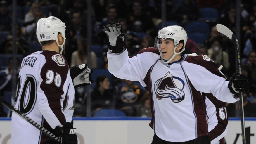 Colorado Avalanche center Ryan O'Reilly (90) celebrates a goal by center Matt Duchene (9) during the second period of an NHL hockey game against the Buffalo Sabres in Buffalo, N.Y., Saturday, Oct. 19, 2013. (AP Photo/Gary Wiepert)
