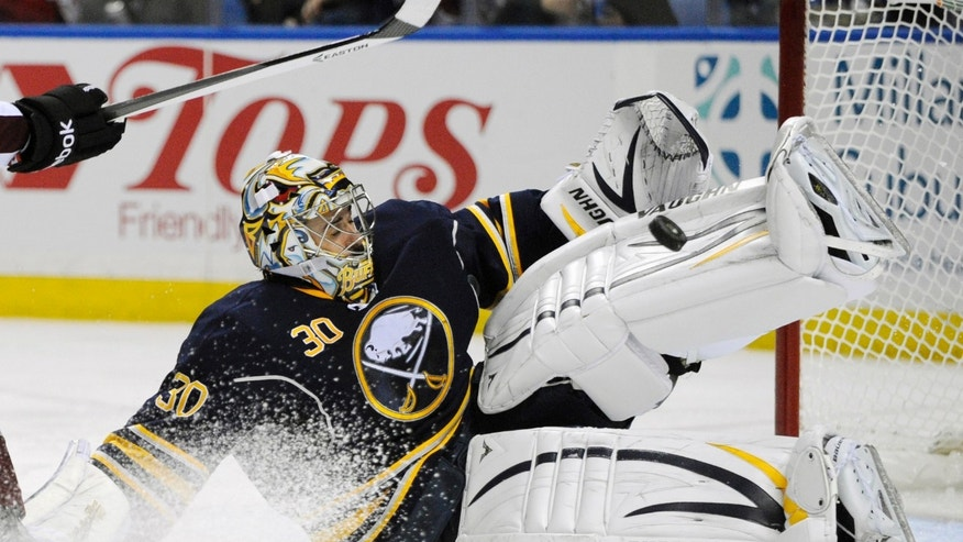 Buffalo Sabres goaltender Ryan Miller makes save on a Colorado Avalanche shot during the second period of an NHL hockey game in Buffalo, N.Y., Saturday, Oct. 19, 2013. (AP Photo/Gary Wiepert)