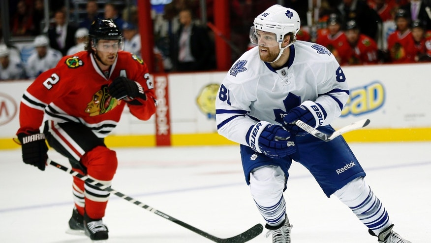 Toronto Maple Leafs right wing Phil Kessel (81) chases the puck with Chicago Blackhawks defenseman Duncan Keith (2) during the first period of an NHL hockey game Saturday, Oct. 19, 2013, in Chicago. (AP Photo/Andrew A. Nelles)