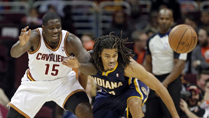 Indiana Pacers' Chris Copeland, right, defends against Cleveland Cavaliers' Anthony Bennett (15) in the second quarter of a preseason NBA basketball game Saturday, Oct. 19, 2013, in Cleveland. (AP Photo/Mark Duncan)