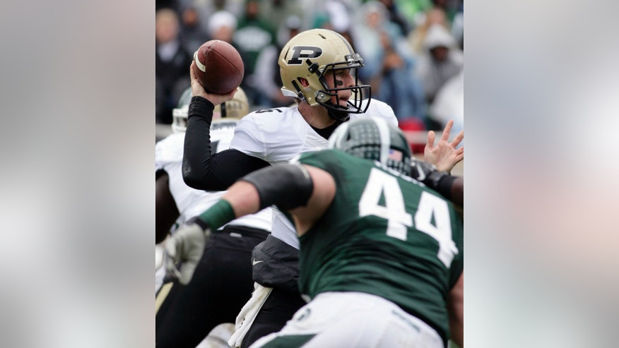 Purdue quarterback Danny Etling throws a pass as Michigan State's Marcus Rush (44) pursues during the second quarter of an NCAA college football game, Saturday, Oct. 19, 2013, in East Lansing, Mich. (AP Photo/Al Goldis)