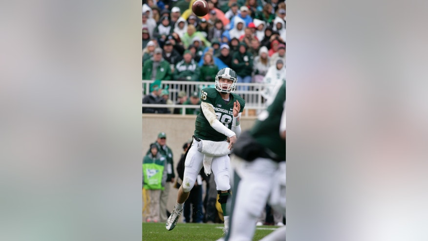 Michigan State quarterback Connor Cook throws a pass during the second quarter of an NCAA college football game against Purdue, Saturday, Oct. 19, 2013, in East Lansing, Mich. (AP Photo/Al Goldis)