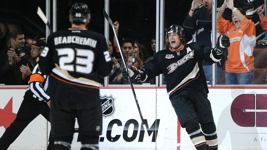 Anaheim Ducks' Teemu Selanne, right, of Finland, celebrates after scoring against the Phoenix Coyotes during the first period of an NHL hockey game Friday, Oct. 18, 2013, in Anaheim, Calif. (AP Photo/Jae C. Hong)