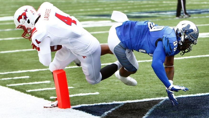 SMU's Collin LaGasse (4) scrambles for a touchdown against Memphis' Reggis Ball, right, during first half of an NCAA college football game in Memphis, Tenn., Saturday, Oct. 19, 2013. (AP Photo/The Commercial Appeal, Mark Weber)