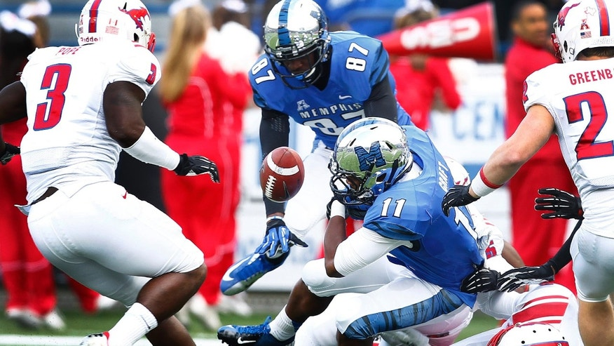 Memphis' Sam Craft (11) fumbles the ball against the SMU  during first half of an NCAA college football game in Memphis, Tenn., Saturday, Oct. 19, 2013. (AP Photo/The Commercial Appeal, Mark Weber)