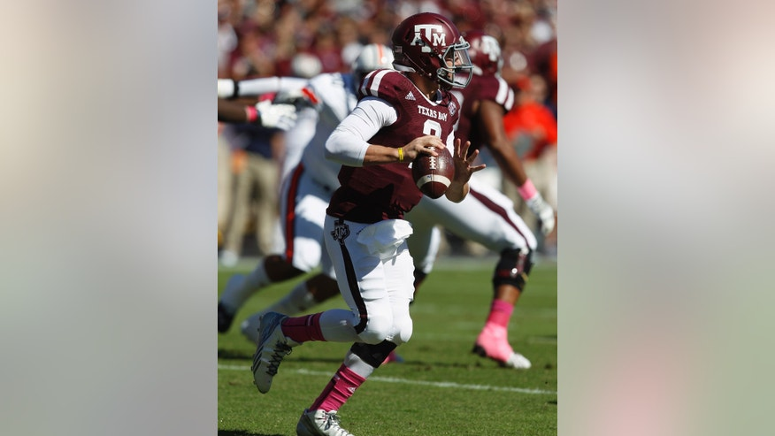 Texas A&M quarterback Johnny Manziel (2) scrambles out of the pocket as he looks for a receiver against Auburn in the first quarter during an NCAA college football game Saturday, Oct. 19, 2013, in College Station, Texas. (AP Photo/Bob Levey)