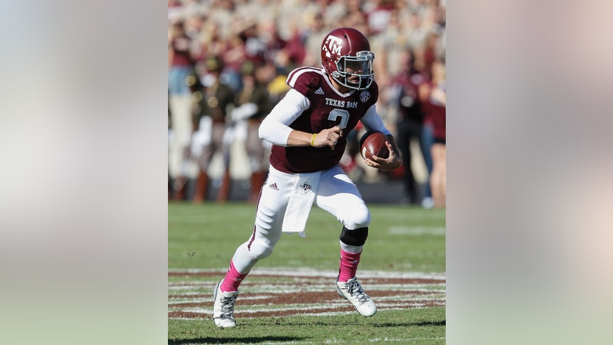 Texas A&M quarterback Johnny Manziel runs with the ball in the second quarter against Auburn during an NCAA college football game Saturday, Oct. 19, 2013, in College Station, Texas. (AP Photo/Bob Levey)