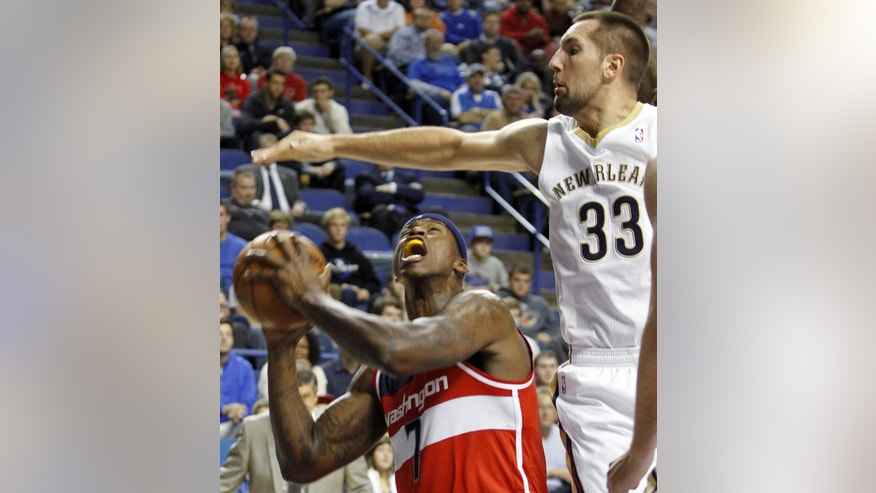 Washington's Al Harrington, left, looks for an opening on New Orleans' Ryan Anderson during an NBA basketball exhibition game on Saturday, Oct. 19, 2013, in Lexington, Ky. (AP Photo/James Crisp)