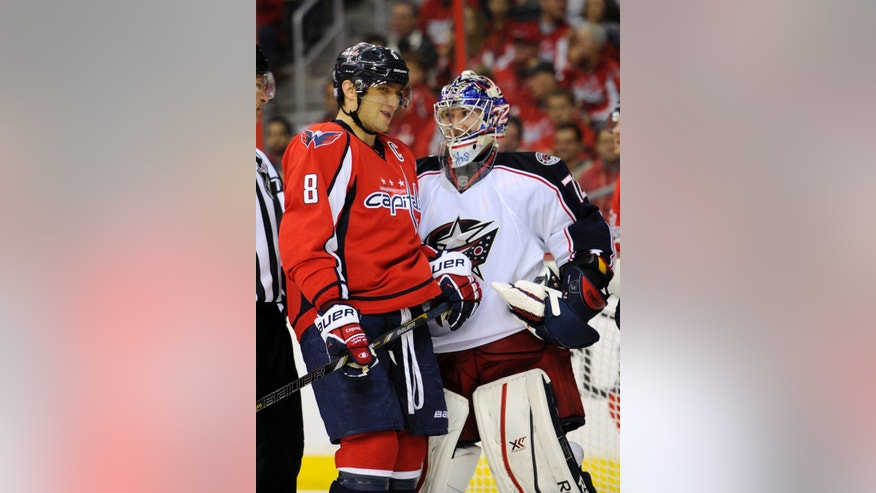 Washington Capitals right wing Alex Ovechkin (8), of Russia, stands next to Columbus Blue Jackets goalie Sergei Bobrovsky, right, of Russia, during the first period an NHL hockey game, Saturday, Oct. 19, 2013, in Washington. (AP Photo/Nick Wass)