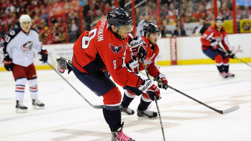 Washington Capitals right wing Alex Ovechkin (8), of Russia, shoots the puck against the Columbus Blue Jackets during the first period an NHL hockey game, Saturday, Oct. 19, 2013, in Washington. (AP Photo/Nick Wass)