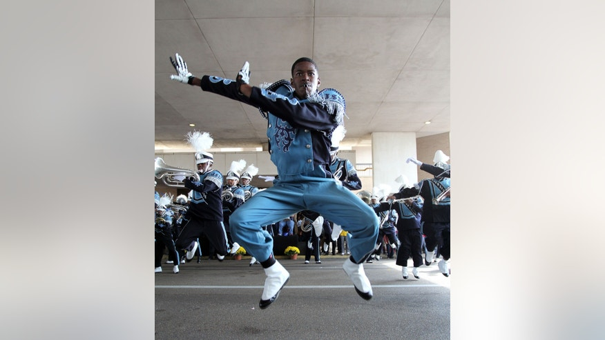 "Jackson State University ""Sonic Boom of the South"" drum major dances during the annual homecoming day parade, Saturday, Oct. 19, 2013, in Jackson, Miss. Jackson State decided to continue with homecoming festivities after Saturday's NCAA college football game game against Grambling State was cancelled because disgruntled Grambling players refused to travel to Jackson.  (AP Photo/Charles Smith)"