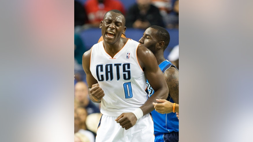 Charlotte Bobcats' Bismack Biyombo (0) reacts after scoring in the first half of a preseason NBA game at the Greensboro Coliseum in Greensboro, N.C., Saturday, Oct. 19, 2013. (AP Photo/Lynn Hey)