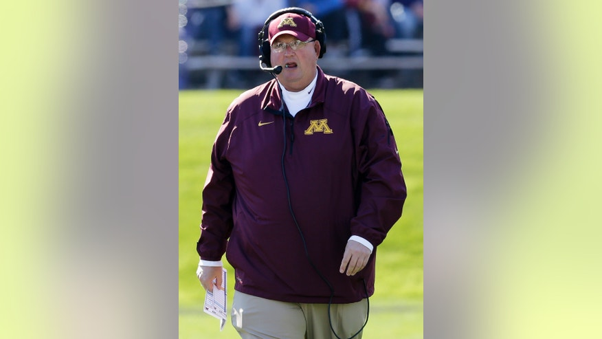 Minnesota interim head coach Tracy Claeys talks on the sideline during the first half of an NCAA college football game against Northwestern Saturday, Oct. 19, 2013,   in Evanston, Ill.  (AP Photo/Nam Y. Huh)