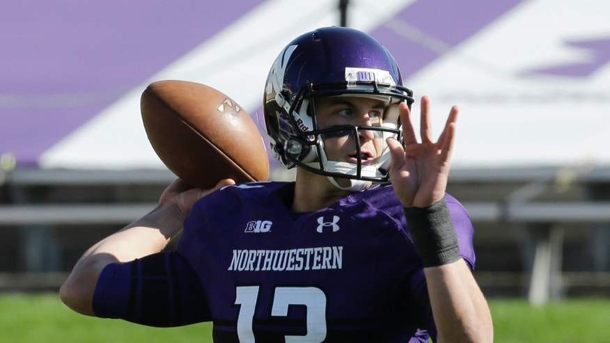 Northwestern quarterback Trevor Siemian (13) looks to a pass during the first half of an NCAA college football game against Minnesota in Evanston, Ill., Saturday, Oct. 19, 2013. (AP Photo/Nam Y. Huh)