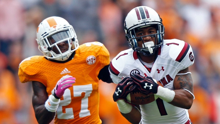 South Carolina wide receiver Damiere Byrd (1) catches a pass for a touchdown as he's defended by Tennessee defensive back Justin Coleman (27) in the second quarter of an NCAA college football game on Saturday, Oct. 19, 2013, in Knoxville, Tenn. (AP Photo/Wade Payne)