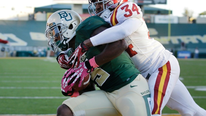 Baylor 's Antwan Goodley, left, scores a touchdown as Iowa State 's Nigel Tribune (34) defends in the first half of an NCAA college football game, Saturday, Oct. 19, 2013, in Waco, Texas. (AP Photo/Tony Gutierrez)