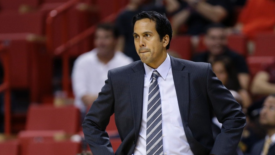 Miami Heat head coach Erik Spoelstra watches during the first half of an NBA preseason basketball game against the San Antonio Spurs, Saturday, Oct. 19, 2013, in Miami. (AP Photo/Lynne Sladky)