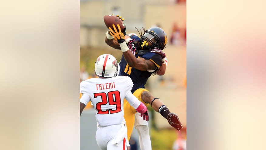 West Virginia's Kevin White (11) catches a pass over Texas Tech's  Olaoluwa Falemi (29) and Austin Stewart (3) during the second quarter of an NCAA college football game in Morgantown, W.Va., on Saturday, Oct. 19, 2013. (AP Photo/Christopher Jackson)
