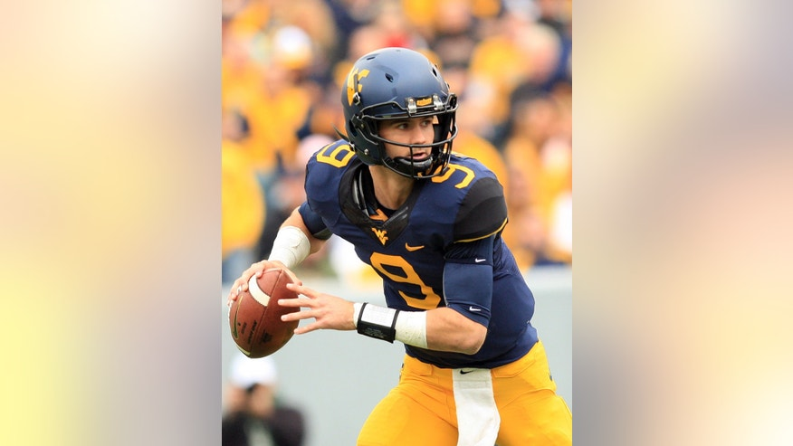 West Virginia quarterback Clint Trickett (9) rolls out of the end zone during the second quarter of their NCAA college football game against Texas Tech in Morgantown, W.Va., on Saturday, Oct. 19, 2013. (AP Photo/Chris Jackson)