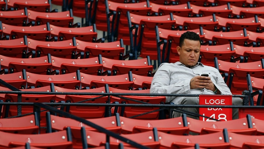 Detroit Tigers' Miguel Cabrera sits in the Fenway Park stands before Game 6 of the American League baseball championship series against the Boston Red Sox on Saturday, Oct. 19, 2013, in Boston. (AP Photo/Elise Amendola)