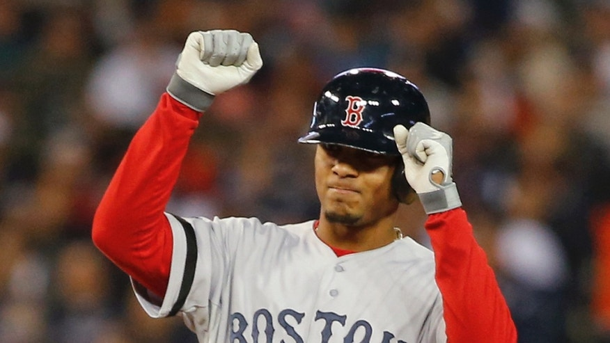 Boston Red Sox's Xander Bogaerts reacts after hitting a double in the second inning during Game 5 of the American League baseball championship series against the Detroit Tigers, Thursday, Oct. 17, 2013, in Detroit. (AP Photo/Paul Sancya)
