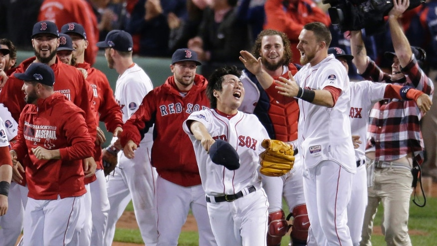 Boston Red Sox relief pitcher Koji Uehara, front, celebrates with teammates after the Red Sox beat the Detroit Tigers 5-2 in Game 6 of the American League baseball championship series on Saturday, Oct. 19, 2013, in Boston. Uehara was named the series' most valuable player, and the Red Sox advance to the World Series. (AP Photo/Charlie Riedel)