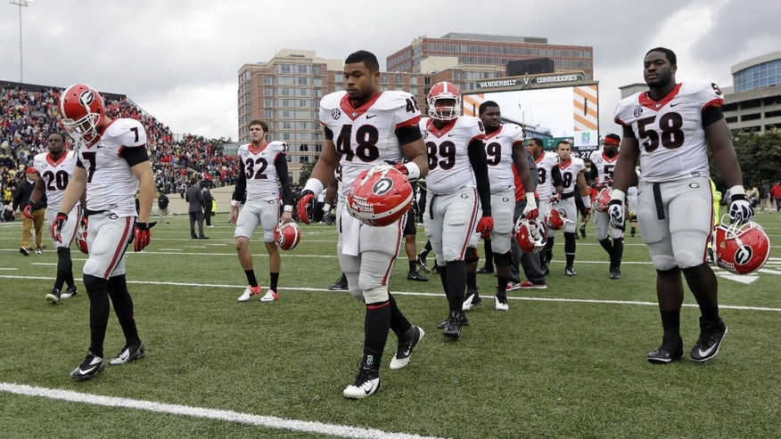 Georgia players walk off the field after losing to Vanderbilt 31-27 in an NCAA college football game on Saturday, Oct. 19, 2013, in Nashville, Tenn. (AP Photo/Mark Humphrey)