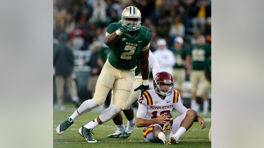 Baylor defensive end Shawn Oakman (2) celebrates after assisting on a sack of Iowa State quarterback Sam B. Richardson (12) in the first half of an NCAA college football game, Saturday, Oct. 19, 2013, in Waco, Texas. (AP Photo/Tony Gutierrez)