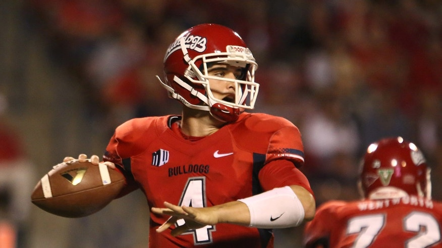 Fresno State's Derek Carr looks to pass during the first half of an NCAA college football game Saturday, Oct. 19, 2013, in Fresno, Calif. (AP Photo/Gary Kazanjian)