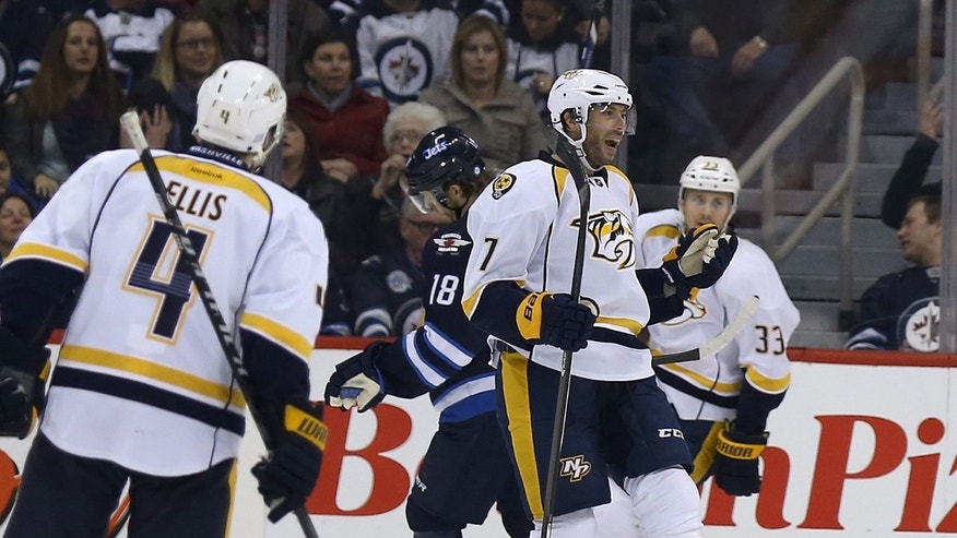 Nashville Predators' Matt Cullen (7) celebrates after scoring against the Winnipeg Jets' during first period NHL hockey action in Winnipeg, Manitoba, Sunday, Oct. 20, 2013.  (AP Photo/The Canadian Press, Trevor Hagan)
