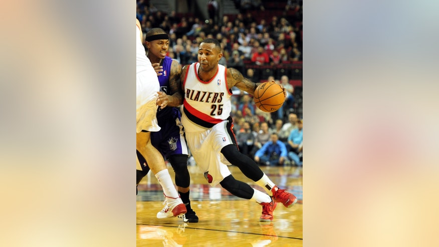Portland Trail Blazers guard Mo Williams (25) dries to the basket past Sacramento Kings guard Isaiah Thomas (22) during the first half of an NBA basketball game Sunday, Oct. 20, 2013, in Milwaukee. (AP Photo/Steve Dykes)