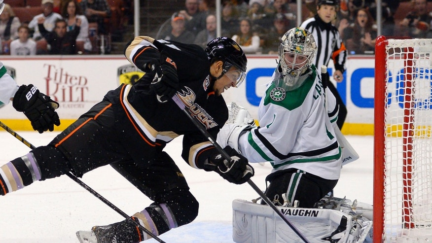 Anaheim Ducks right wing Emerson Etem, left, scores on Dallas Stars goalie Jack Campbell during the second period of their NHL hockey game, Sunday, Oct. 20, 2013, in Anaheim, Calif. (AP Photo/Mark J. Terrill)