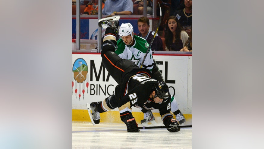 Anaheim Ducks defenseman Francois Beauchemin, below, trips over Dallas Stars left wing Jamie Benn during the first period of their NHL hockey game Sunday, Oct. 20, 2013, in Anaheim, Calif. (AP Photo/Mark J. Terrill)