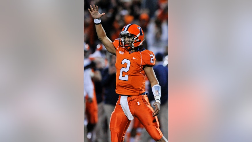 Illinois quarterback Nathan Scheelhaase (2), celebrates after running back Josh Ferguson rushed for a touchdown during the second quarter of NCAA college football game against Wisconsin in Champaign, Ill., Saturday, Oct. 19, 2013. (AP Photo/Paul Beaty)